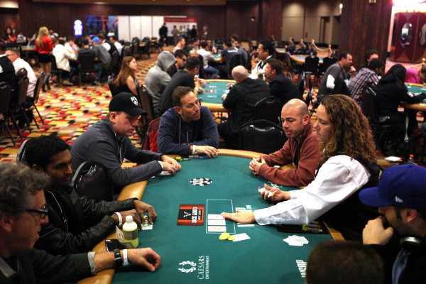 In this photo taken Saturday, Jan. 19, 2013, Recruits play poker during the MBA Poker Championship and Recruitment Weekend at Planet Hollywood in Las Vegas.(AP Photo/Las Vegas Sun, Leila Navidi)
